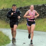Holly and Mark do battle in the rain. Photo courtsey of Trawden A.C.