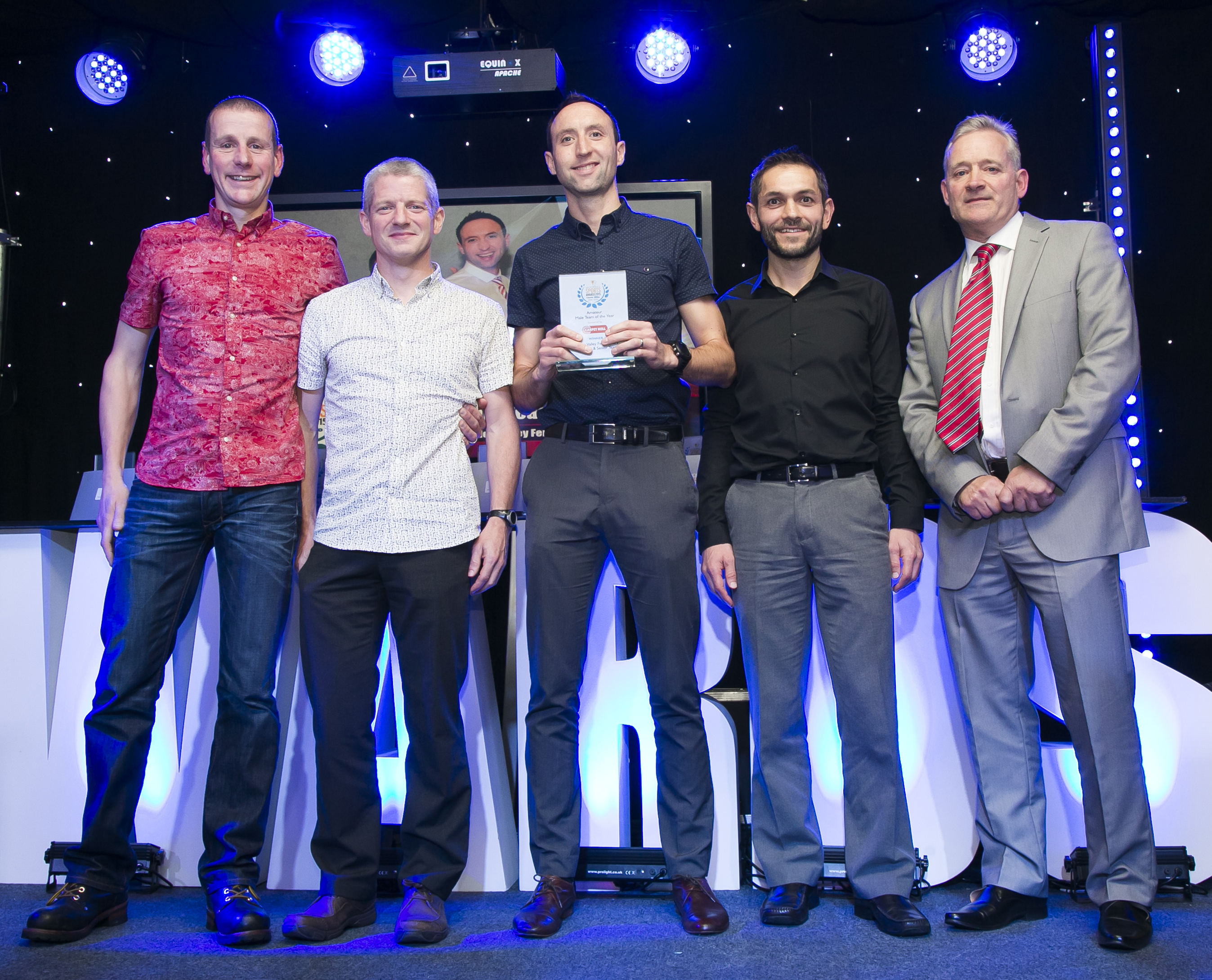 winners of the Amateur Male Team of the Year, Calder Valley Fell Runners Mens over 40s and Senior Team, Shaun Godsman, James Logue, Ben Mounsey and Karl Gray with Halifax Courier Sports Editor Ian Rushworth.