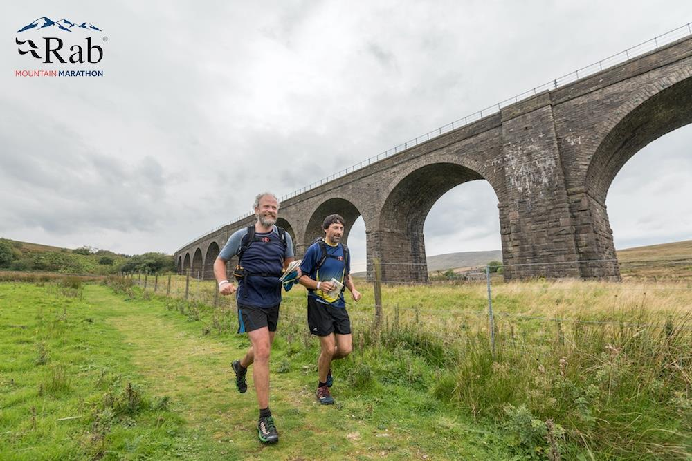 Tim Brooks running with partner Peter on day 2 (Photo by RAB Mountain Marathon)
